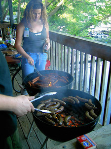 Karla and Becky cooked the hotdogs and brats.