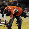 A member of a fraternity on campus holds a Miami player, symbolizing  at Seminole Uprising, held on August 31, 2009 at Tully Gym.
