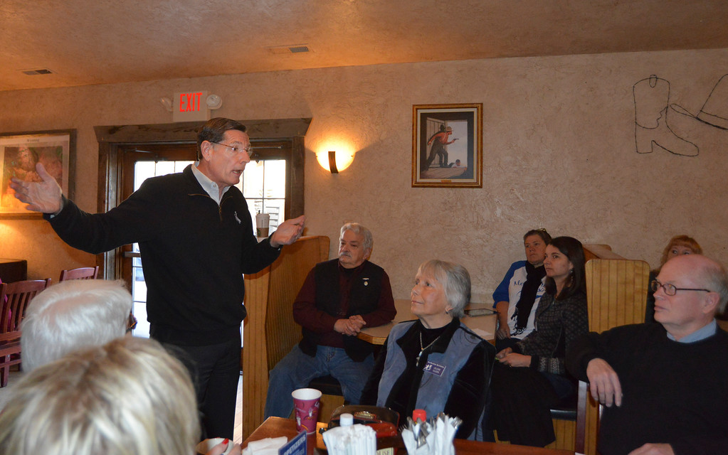Justin Sheely | The Sheridan Press<br /> Sen. John Barrasso, R-Wyoming, speaks during the Chamber Coffee Discussion Wednesday in the Big Horn Smokehouse & Saloon at Big Horn. Several protesters turned out for the event hosted by the Sheridan County Chamber of Commerce. The group challenged Barrasso on environmental issues despite that the Chamber Coffee was intended for business and commerce discussion.