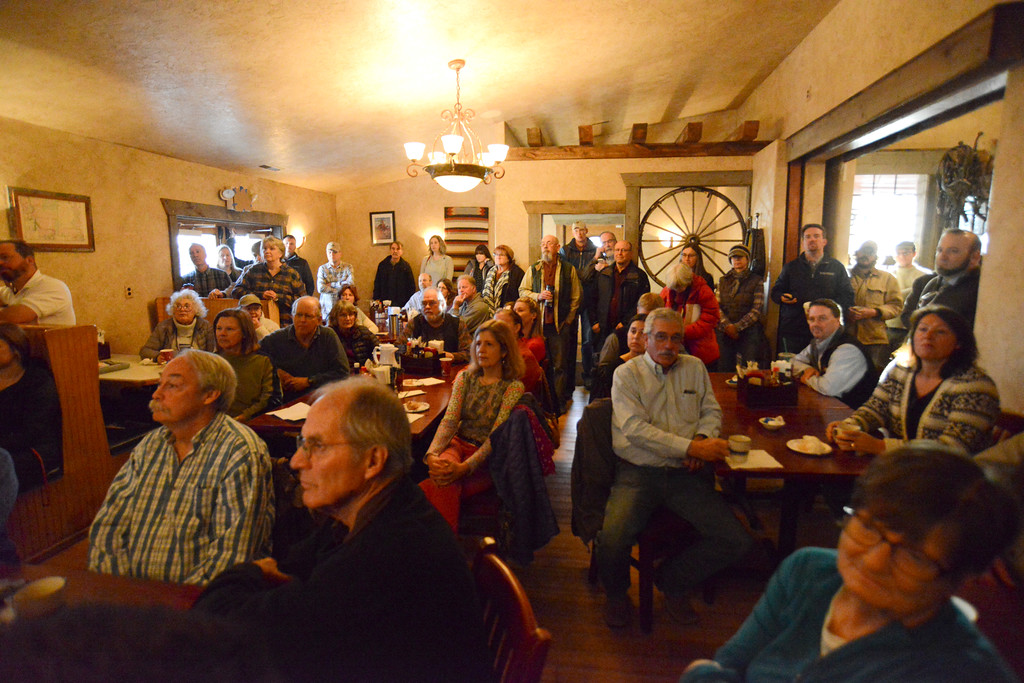 Justin Sheely | The Sheridan Press<br /> Attendees gather inside the Big Horn Smokehouse & Saloon during Sen. John Barrasso's visit for the Chamber Coffee Discussion Wednesday in Big Horn. Several protesters turned out for the event hosted by the Sheridan County Chamber of Commerce. The group challenged Barrasso on environmental issues despite that the Chamber Coffee was intended for business and commerce discussion.
