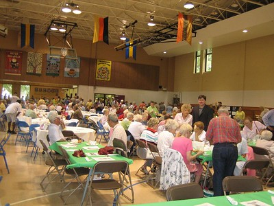 Approximately 500 seniors bought tickets for the Senior Fest, which was planned for an outdoor park. Rain forced the event indoors, and still hundreds of seniors attended.