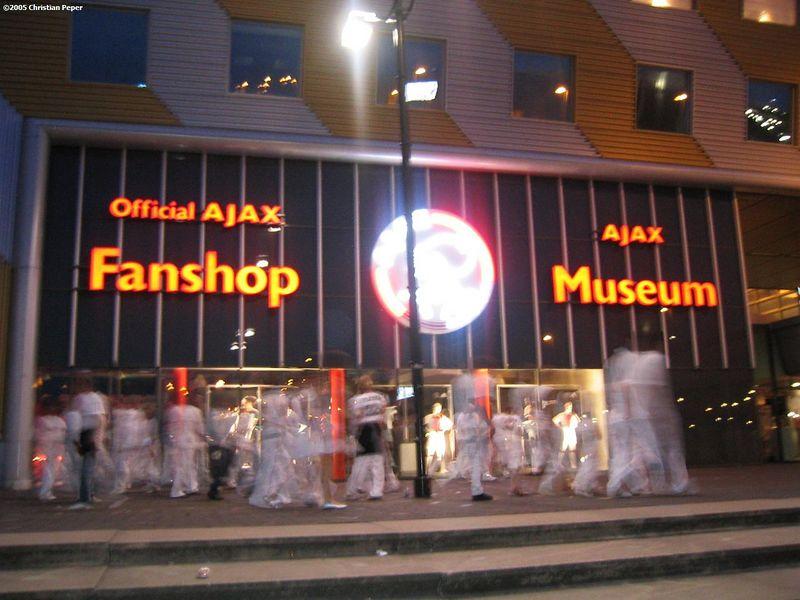 party people walking by Ajax fan store