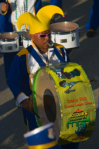 Drum member in Orange Walk Central Drum Corp. in Independence Parade, Orange Walk Town, Orange Walk, Belize.