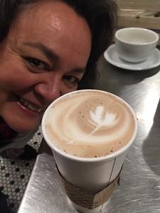 Lisa photobombing my Cafe Mocha!