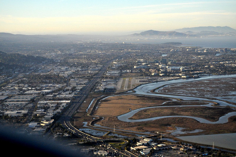 San Carlos Airport is near the center of this shot...
