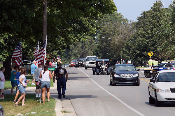 Record-Eagle/Keith King<br /> The funeral procession carrying the body of United States Marine Sgt. Justin Hansen travels on Veterans Drive from the Justin Hansen funeral service at Kingsley High School Saturday, August 4, 2012 toward Grand Traverse Memorial Gardens in Traverse City.