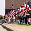 Record-Eagle/Keith King<br /> Flags are held outside Kingsley High School Saturday, August 4, 2012 prior to the funeral service for United States Marine Sgt. Justin Hansen.