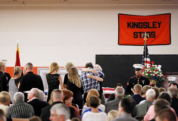 Record-Eagle/Keith King<br /> Vickie Hays shares a hug Saturday, August 4, 2012 during the funeral for her son, United States Marine Sgt. Justin Hansen, at Kingsley High School.
