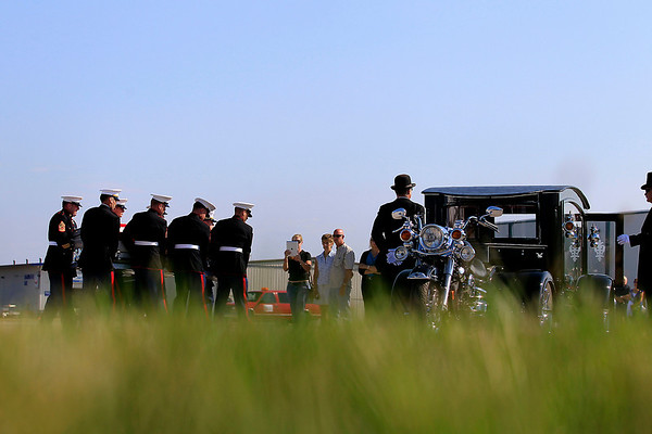 Record-Eagle/Jan-Michael Stump<br /> A United State Marine Honor Guard receives the body of Sgt. Justin Hansen, a 26 year-old Kingsley native who was killed while conducting combat operations in Afghanistan July 24. Sgt. Hansen was carried in a 2009 Tombstone Hearse and Harley Davidson Road King Conversion, volunteered for service by Jay Howard and David Censke of Battle Creek A procession, led by a Marine on Sgt. Hansen's custom Harley Davidson motorcycle, took his body from Cherry Capitol Airport to Kingsley. Hansen's visitation and funeral will be at Kingsley High School today. Visitation will begin at 11 a.m. and the funeral will be held at 1 p.m. Following the funeral service, a procession will head to Memorial Gardens off Veterans Drive in Garfield Township. The procession will head west on M-113 to M-37, north on M-37 to Fourteenth Street, right on Fourteenth Street to Veterans Drive and south on Veterans Drive to Memorial Gardens.