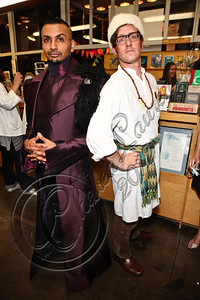 "LOS ANGELES, CA - JUNE 04:  Illustrator Aman Chaudhary (L) and a guest dressed in clothing inspired by the ""Tsarpunk"" style of Leigh Bardugo's Grisha Trilogy pose at the ""Shadow and Bone"" book launch party at Skylight Books on June 4, 2012 in Los Angeles, California.  (Photo by Chelsea Lauren/WireImage)"