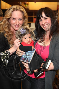 "LOS ANGELES, CA - JUNE 04:  Author Leigh Bardugo (L) poses with fans dressed in the ""Tsarpunk"" style of her Grisha Trilogy at the ""Shadow and Bone"" book launch party at Skylight Books on June 4, 2012 in Los Angeles, California.  (Photo by Chelsea Lauren/WireImage)"