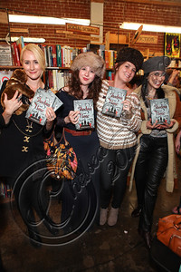 "LOS ANGELES, CA - JUNE 04:  Fans dressed in clothing inspired by the ""Tsarpunk"" style of Leigh Bardugo's Grisha Trilogy pose at the ""Shadow and Bone"" book launch party at Skylight Books on June 4, 2012 in Los Angeles, California.  (Photo by Chelsea Lauren/WireImage)"