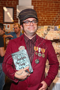 "LOS ANGELES, CA - JUNE 04:  A fan dressed in clothing inspired by the ""Tsarpunk"" style of Leigh Bardugo's Grisha Trilogy poses at the ""Shadow and Bone"" book launch party at Skylight Books on June 4, 2012 in Los Angeles, California.  (Photo by Chelsea Lauren/WireImage)"