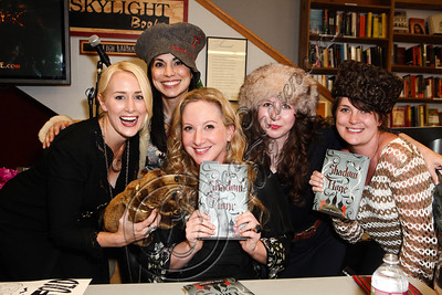 "LOS ANGELES, CA - JUNE 04:  Author Leigh Bardugo (C) poses with fans dressed in the ""Tsarpunk"" style of her Grisha Trilogy at the ""Shadow and Bone"" book launch party at Skylight Books on June 4, 2012 in Los Angeles, California.  (Photo by Chelsea Lauren/WireImage)"