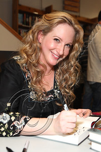 "LOS ANGELES, CA - JUNE 04:  Author Leigh Bardugo signs copies of her debut novel ""Shadow And Bone"" at Skylight Books on June 4, 2012 in Los Angeles, California.  (Photo by Chelsea Lauren/WireImage)"