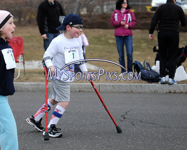 3/19/2011 Mike Orazzi | Staff Kyle Errato makes his way to the finish line during the Kids Fun Run at the 9th Annual Shamrock Run & Walk held at the Chippens Hill Middle School on Saturday morning.
