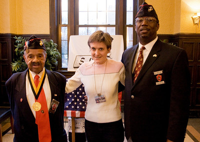Mr. Tillman, Dr. Lynnea Magnuson, Director of the Saint Louis Soldiers Memorial Military Museum, and Lt. Colonel Charles Boyd