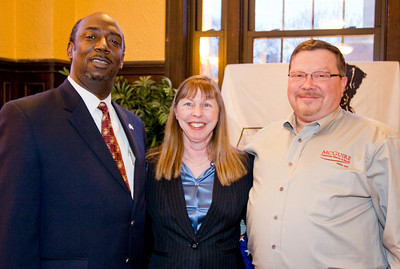 Charles Boyd pictured with S.O.S. Program sponsors, Jan & Jay Titchen of McGuire Furniture Rentals and Sales