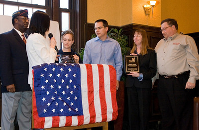 """Lt. Colonel Charles Boyd and Amanda LaPlante of Live Image Group present Michelle & Steven Bross of STL apartments and Jay & Jan Titchen of McGuire Furniture Rental and Sales with """"Plaques of Appreciation"""" for their integral participation in the Shelter Our Soldiers Program."""
