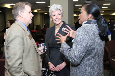 (L-r) Joseph Krygiel, chief executive officer for Catholic Charities Atlanta, Linda Spencer of Holy Spirit Church, Atlanta, and Linda Harrison of St. anthony Church, Atlanta, chat with each other during the reception at Shepherd's Night, Feb. 1.