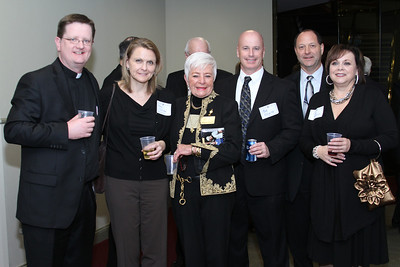 Msgr. Joseph Corbett, vicar general for the Archdiocese of Atlanta, St. Brigid Church parishioners Mary Frericks and Carolyn Daniels, Mark FitzGerald and Andy Gillhouse of Diocesan Publications, and Gina Blackwell of St. Brigid Church gather for a photo before dinner.