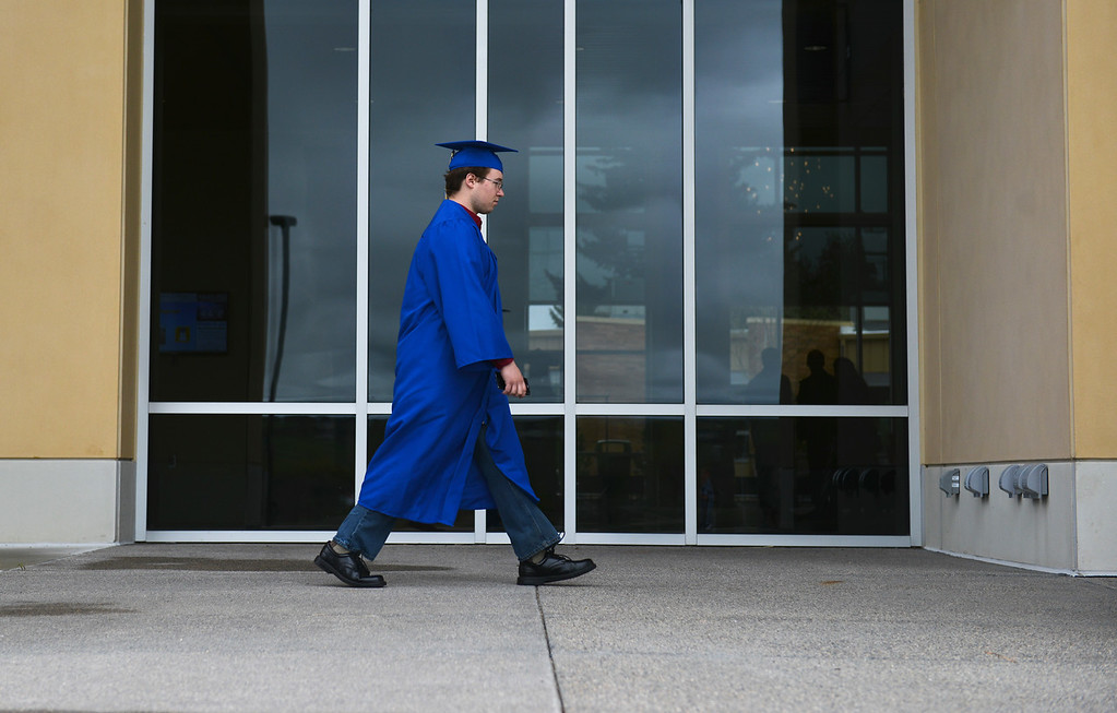 Justin Sheely | The Sheridan Press<br /> A candidate walks to the staging area during the Commencement at Sheridan College Saturday, May 12, 2018.