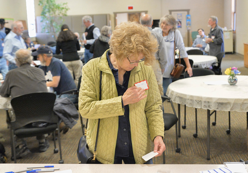 Justin Sheely | The Sheridan Press<br /> Gillian Malone places her name tag during the Sheridan County Democratic Convention at First Christian Church Saturday, April 14, 2018.