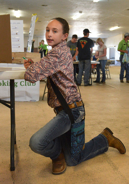 Justin Sheely | The Sheridan Press<br /> Eleven-year-old Jasmine Gorzalka colors a sign for her 4-H club booth in preparation for the Sheridan County Fair at the Sheridan County Fairgrounds Tuesday, July 31, 2018.