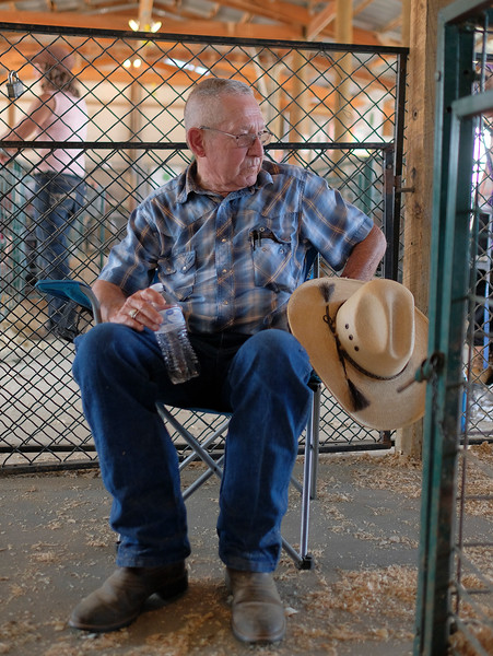 Justin Sheely | The Sheridan Press<br /> NSI youth counselor and 4-H instructor Rod Penfold rests for a while during the Sheridan County Fair at the Sheridan County Fairgrounds sale barn Thursday, Aug. 2, 2018.