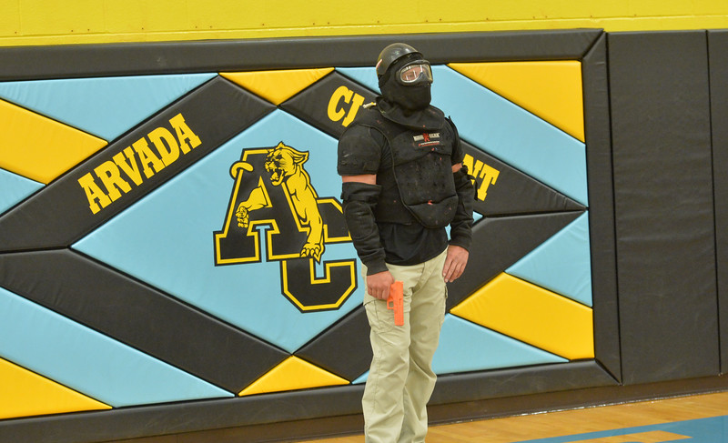 Ryan Patterson | The Sheridan Press<br /> TAC*ONE Consulting founder and president Joe Deedon prepares to simulate an active shooterduring school safety training at the Arvada/Clearmont K-12 School Thursday, Nov. 29, 2018. Students, educators, community members and law enforcement participated in training over the course of three days.