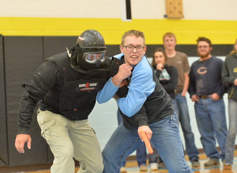 Ryan Patterson | The Sheridan Press<br /> TAC*ONE Consulting founder and president Joe Deedon, left, and Arvada-Clearmont High School senior Mason Beam simulate responding to an active shooterduring school safety training at the Arvada/Clearmont K-12 School Thursday, Nov. 29, 2018. Students, educators, community members and law enforcement participated in training over the course of three days.