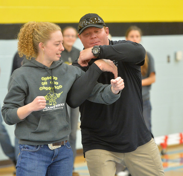 Ryan Patterson | The Sheridan Press<br /> Arvada-Clearmont High School senior Kristin Klaahsen, left, and TAC*ONE Consulting trainer Brian Pollard prepare to simulate an active shooter scenario during school safety training at the Arvada/Clearmont K-12 School Thursday, Nov. 29, 2018. Students, educators, community members and law enforcement participated in training over the course of three days.