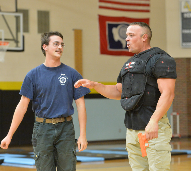Ryan Patterson | The Sheridan Press<br /> TAC*ONE Consulting founder and president Joe Deedon, right, and Arvada-Clearmont High School sophomore John Kleir simulate responding to an active shooter during school safety training at the Arvada/Clearmont K-12 School Thursday, Nov. 29, 2018. Students, educators, community members and law enforcement participated in training over the course of three days.