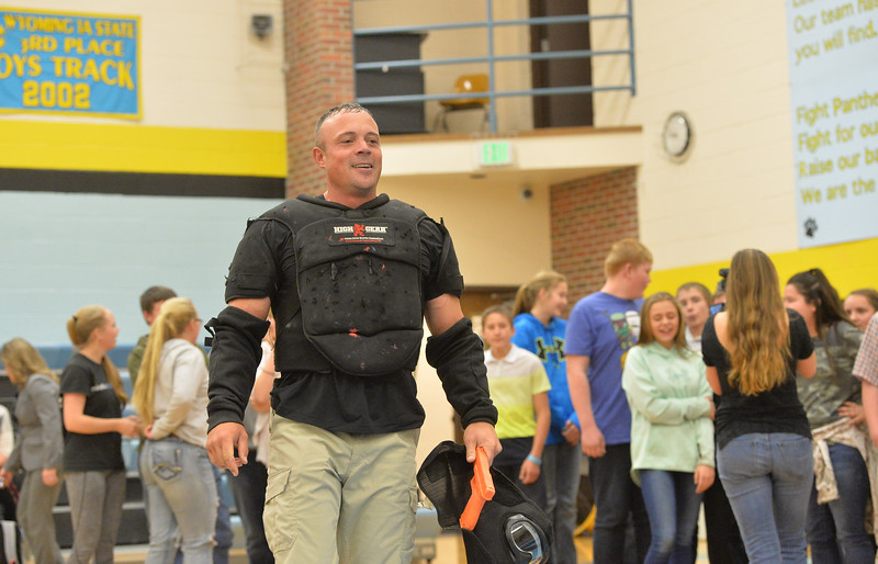Ryan Patterson | The Sheridan Press<br /> TAC*ONE Consulting founder and president Joe Deedon walks after simulating an active shooter scenario during school safety training at the Arvada/Clearmont K-12 School Thursday, Nov. 29, 2018. Students, educators, community members and law enforcement participated in training over the course of three days.