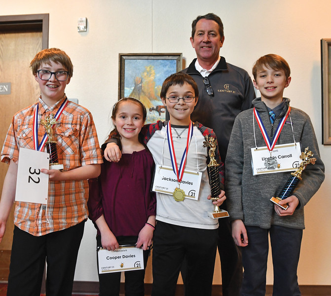 Ryan Patterson | The Sheridan Press<br /> From left: Ethan Milne, Cooper Davies, Jackson Davies, broker-owner of Century 21 BHJ Realty Bruce Garber and Lincoln Carroll gather after the Sheridan County Spelling Bee at the WYO Performing Arts and Education Center Saturday, Feb. 16, 2019. Jackson Davies took first, Carroll placed second and Milne finished third in the spelling bee.