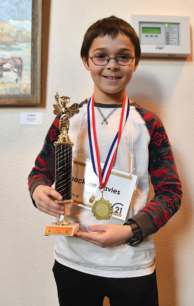 Ryan Patterson | The Sheridan Press<br /> Sheridan Junior High School seventh-grader Jackson Davies holds his first-place trophy after the Sheridan County Spelling Bee at the WYO Performing Arts and Education Center Saturday, Feb. 16, 2019.