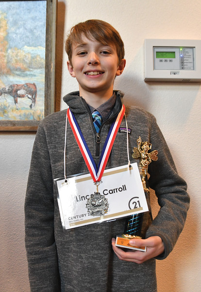 Ryan Patterson | The Sheridan Press<br /> Sheridan Junior High School seventh-grader Lincoln Carroll holds his second-place trophy after the Sheridan County Spelling Bee at the WYO Performing Arts and Education Center Saturday, Feb. 16, 2019.