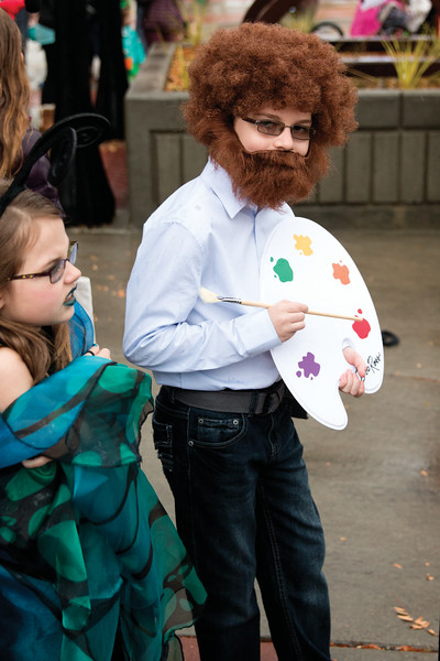 Matthew Gaston | The Sheridan Press<br>Eight-year-old Kaylee Whisler, left, wraps her butterfly wings tight around her shoulders while her big brother Logan Whisler, 10, strikes a pose as Bob Ross at the Halloween Parade Saturday, Oct. 27, 2018.