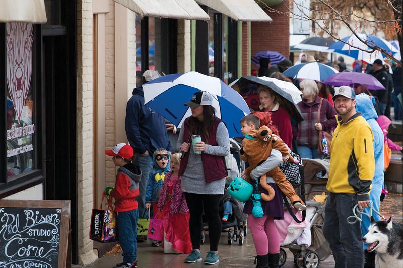 Matthew Gaston | The Sheridan Press<br>Parents walk their costumed childern up Grinnell Plaza toward Main Street during Sheridans annual Halloween Parade Saturday, Oct. 27, 2018.