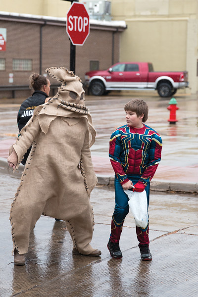 Matthew Gaston | The Sheridan Press<br>Jamie Ostermyer, left and Coen Ostermyer, right, horse around at the Halloween Parade as the Boogie Man and Spiderman Unmasked Saturday, Oct. 27, 2018.