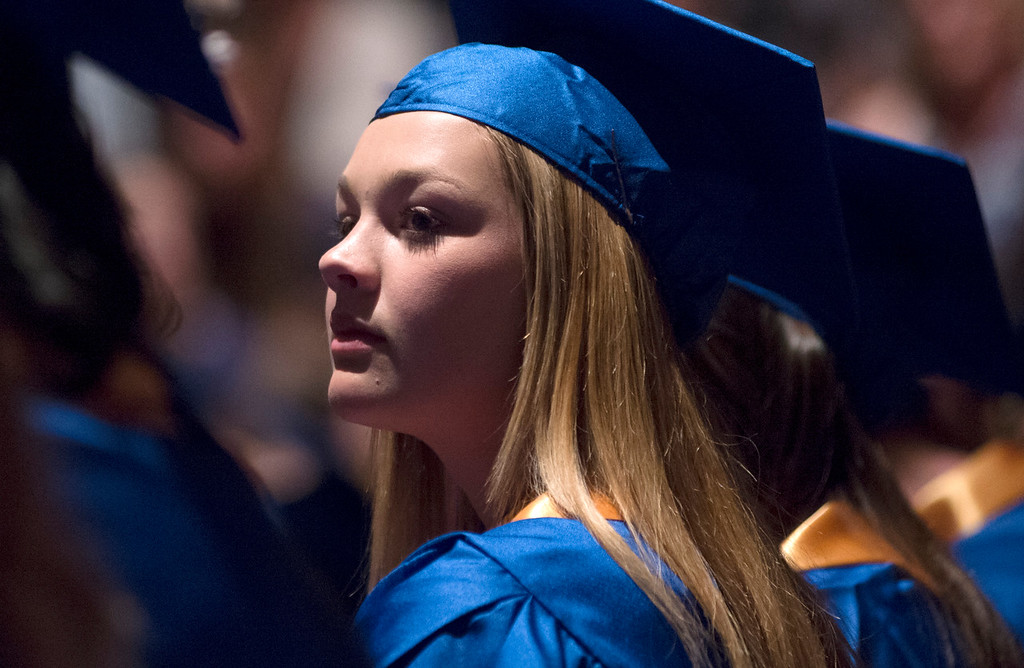 Justin Sheely | The Sheridan Press<br /> Kailee Ingalls listens to the speaker during the class of 2018 commencement ceremony at Sheridan High School Sunday, May 27, 2018.