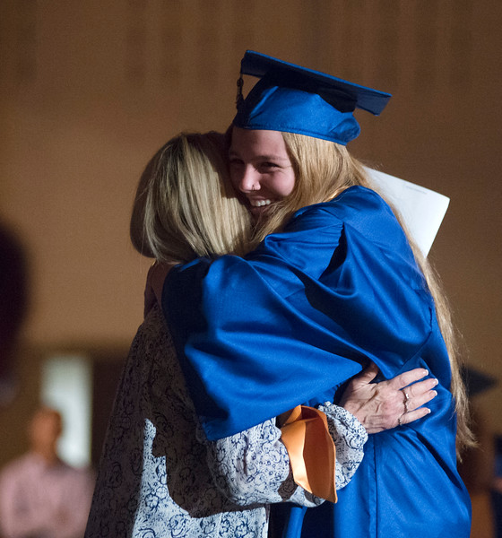 Justin Sheely | The Sheridan Press<br /> Mallarie Apodaca hugs her grandmother Meg Montgomery after receiving her diploma during the class of 2018 commencement ceremony at Sheridan High School Sunday, May 27, 2018.