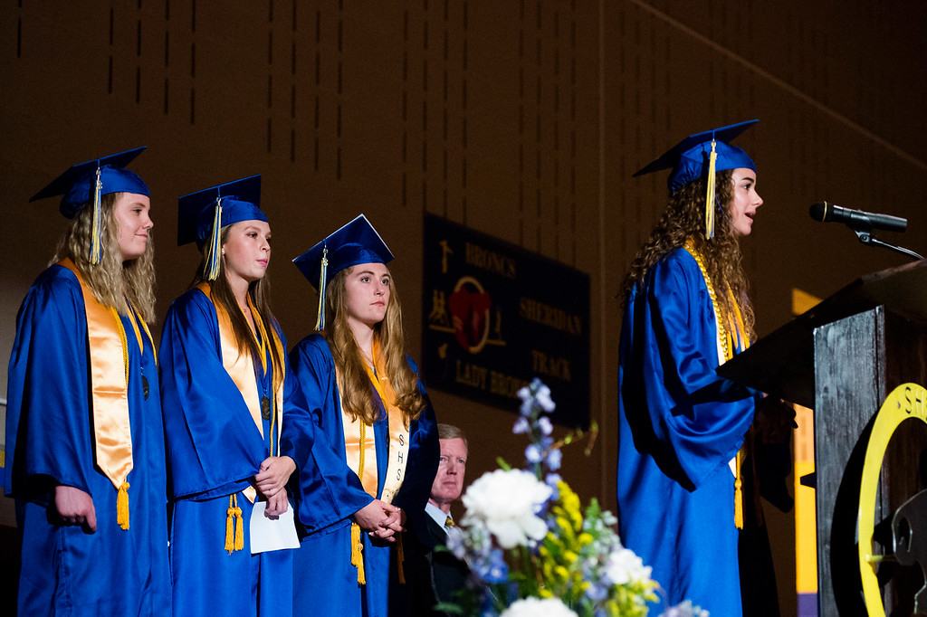 Justin Sheely | The Sheridan Press<br /> Salutatorians, from left, Emmalee Hoopes, Samara Ordahl and Aeirana Roth watch Olivia Thoney speak during the class of 2018 commencement ceremony at Sheridan High School Sunday, May 27, 2018.