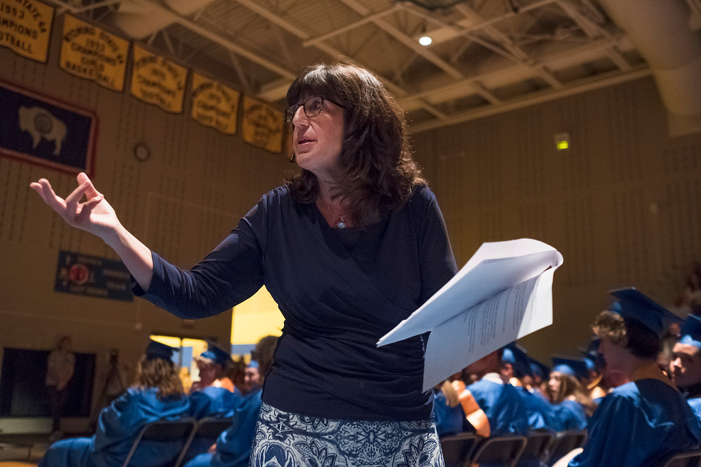 Justin Sheely | The Sheridan Press<br /> Commencement speaker Nancy Crowe walks up the aisle during her speech during the class of 2018 commencement ceremony at Sheridan High School Sunday, May 27, 2018.