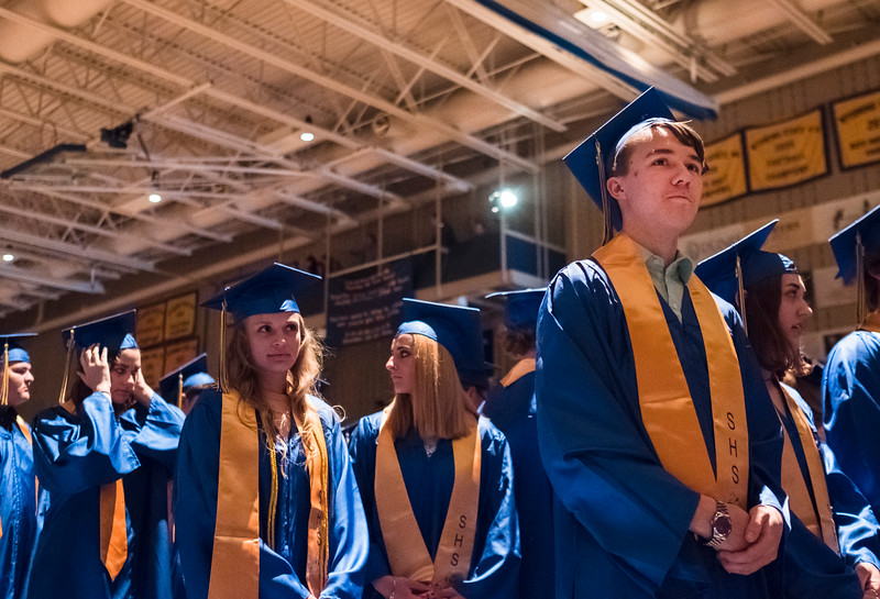 Justin Sheely | The Sheridan Press<br /> Thomas Detmer, right, and his classmates stand during the class of 2018 commencement ceremony at Sheridan High School Sunday, May 27, 2018.