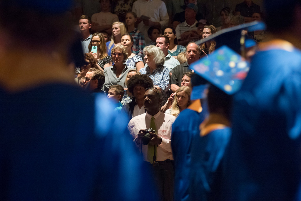 Justin Sheely | The Sheridan Press<br /> Family and friends look on as seniors enter the gymnasium during the class of 2018 commencement ceremony at Sheridan High School Sunday, May 27, 2018.