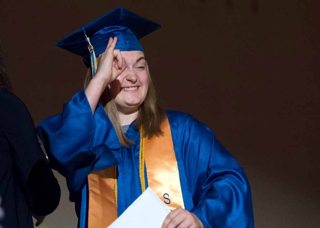 Justin Sheely | The Sheridan Press<br /> Taylor Myers celebrates after receiving her diploma during the class of 2018 commencement ceremony at Sheridan High School Sunday, May 27, 2018.