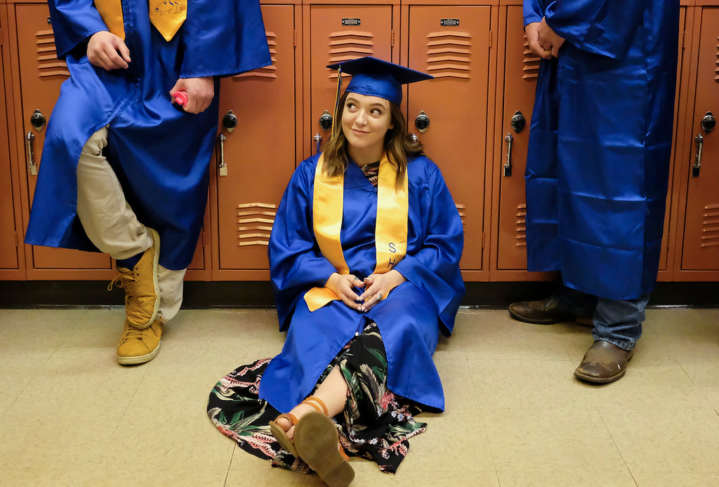 Justin Sheely | The Sheridan Press<br /> Graduating senior Zhoe Calkins waits at the staging area during the class of 2018 commencement ceremony at Sheridan High School Sunday, May 27, 2018.