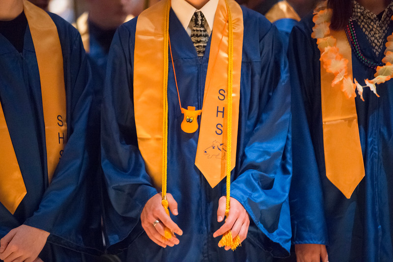 Justin Sheely | The Sheridan Press<br /> Graduating seniors stand for the processional during the class of 2018 commencement ceremony at Sheridan High School Sunday, May 27, 2018.