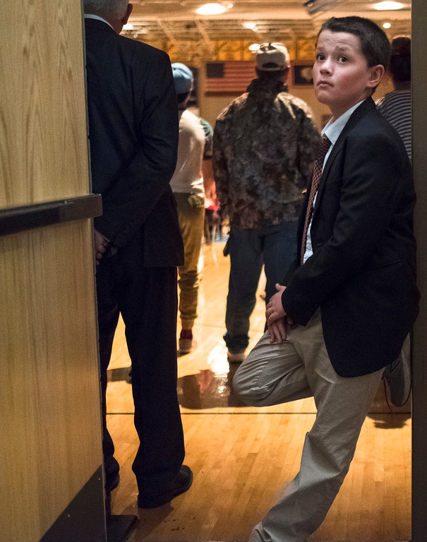 Justin Sheely | The Sheridan Press<br /> Fifth-grader Lorring Prillwitz waits outside the gymnasium to watch his cousin graduate during the class of 2018 commencement ceremony at Sheridan High School Sunday, May 27, 2018.